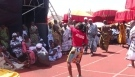 Lady dances to the Kete rhythm